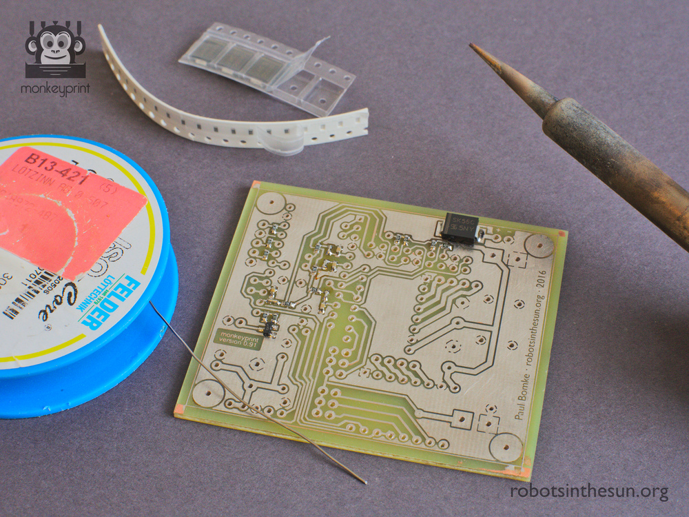 Photograph showing the Monkeyprint DLP printer board and some soldering equipment.