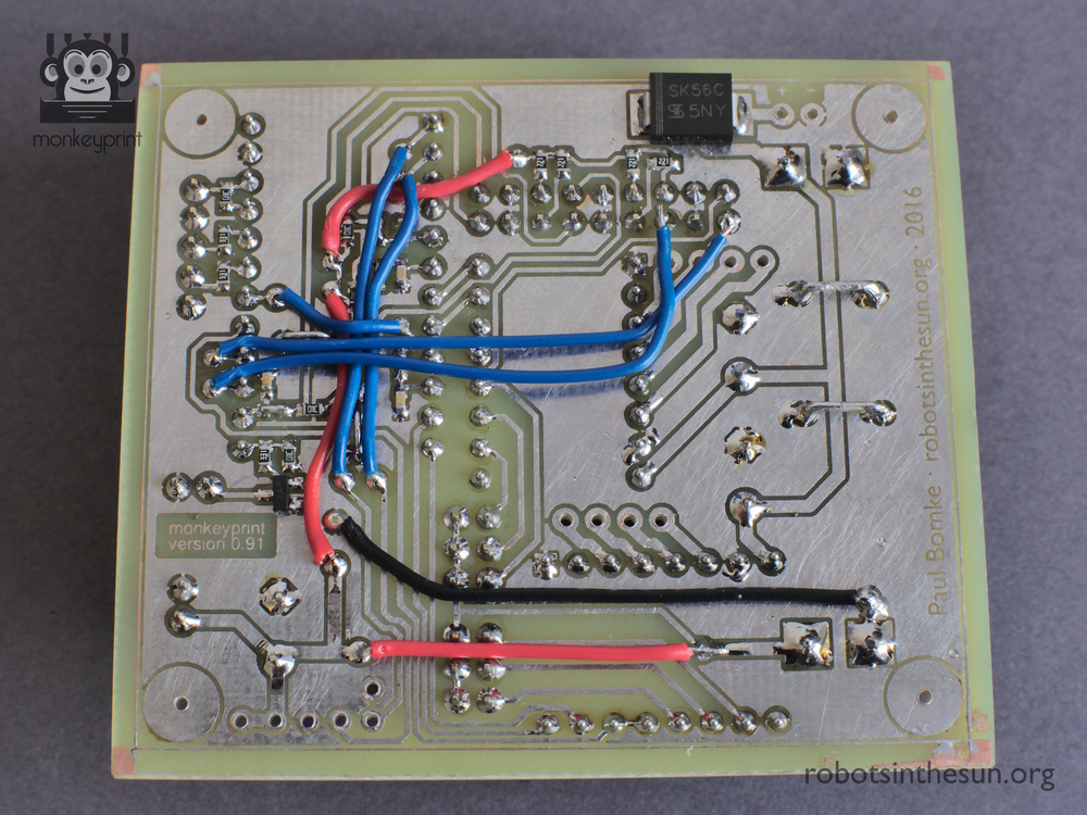 Photograph of the Monkeyprint board bottom side with the wire bridges soldered.