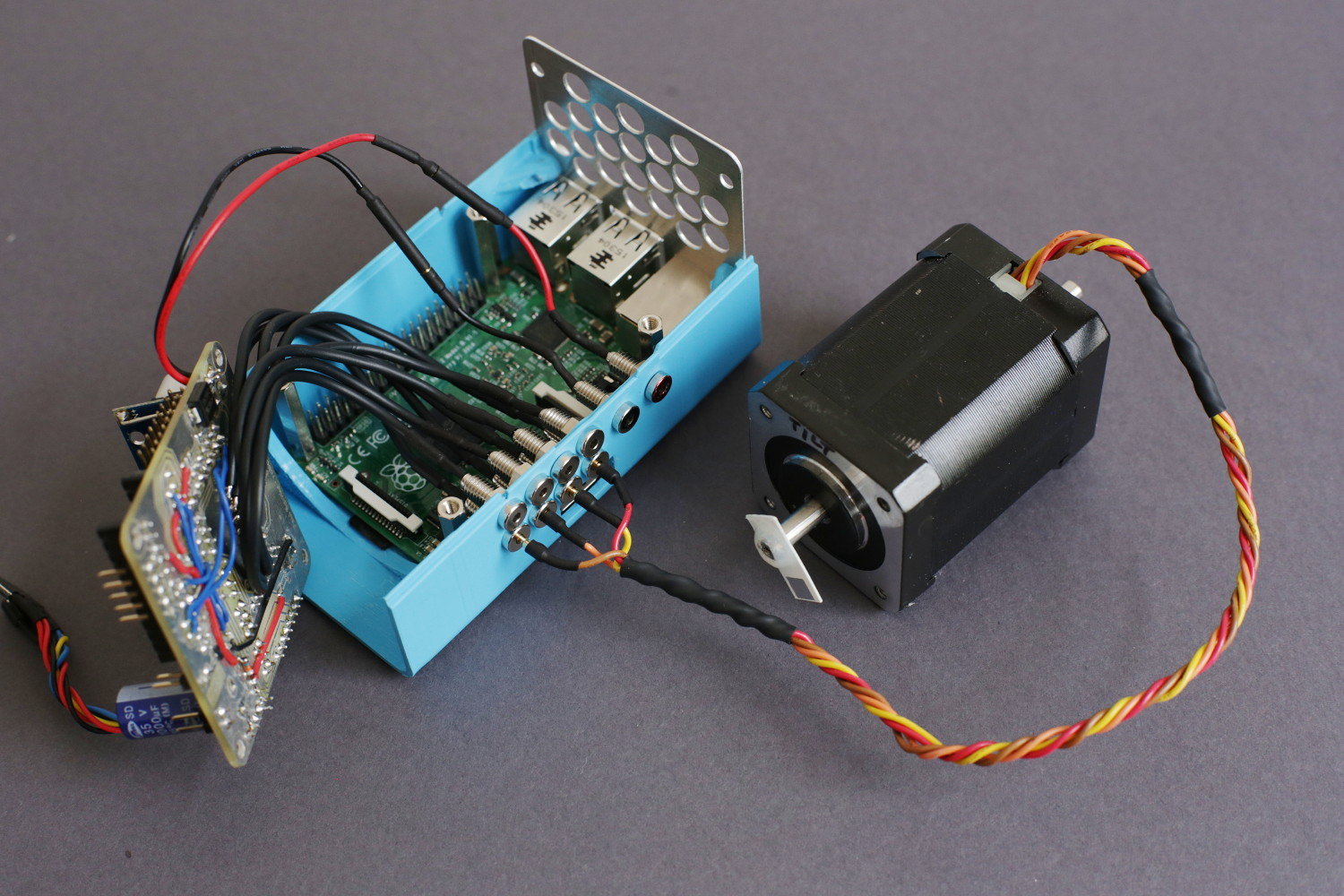 Once you found out your stepper motors color coding for the windings, plug it into the connectors. The order of the connectors is A1 A2 B1 B2 where A and B are the windings and 1 and 2 are the two poles of each winding.
