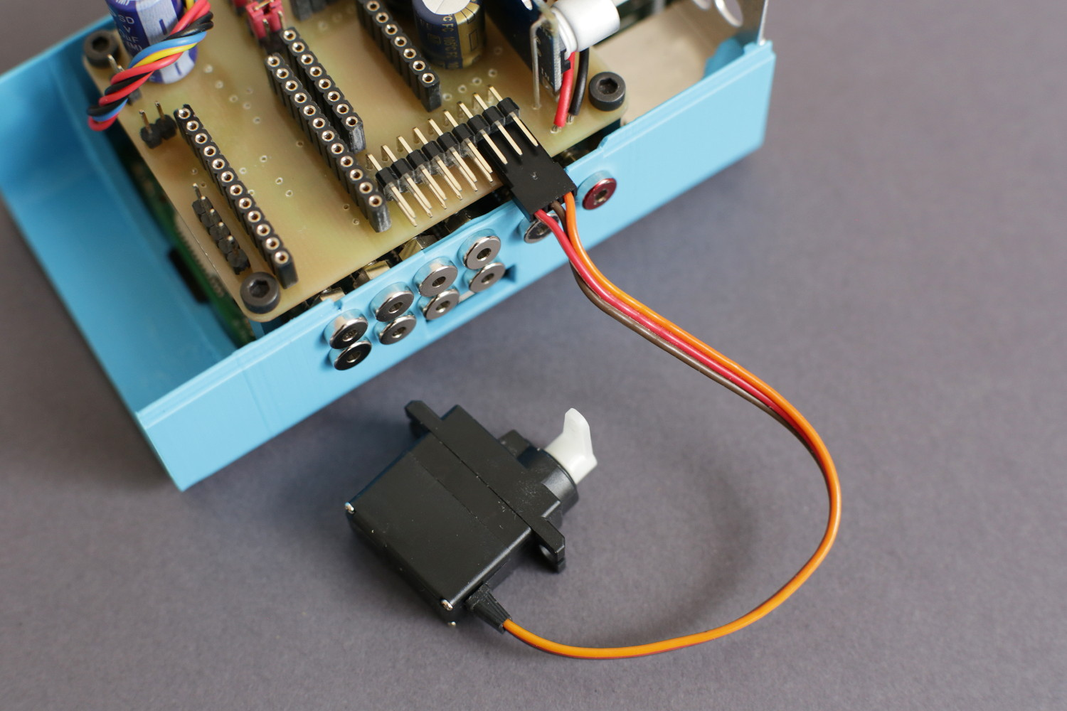 The shutter servo attached to the Monkeyprint DLP printer control board.